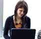 Female student with laptop computer.
