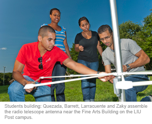 Students building: Quezada, Barrett, Larracuente and Zaky assemble the radio telescope antenna near the Fine Arts Building on the LIU Post campus.