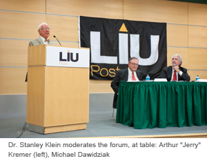Dr. Stanley Klein moderates the forum, at table: Arthur