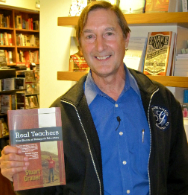 Dr. Stuart Grauer with his recent book