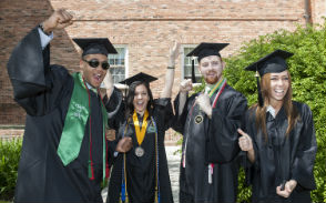 Students in cap and gowns at commencement