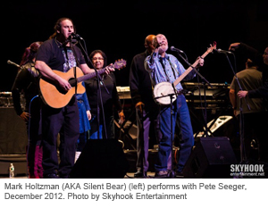 Mark Holtzman (AKA Silent Bear) (left) performs with Pete Seeger, December 2012. Photo by Skyhook Entertainment