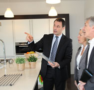Interior Designer showing clients some kitchen options