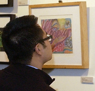Man Viewing Art Work